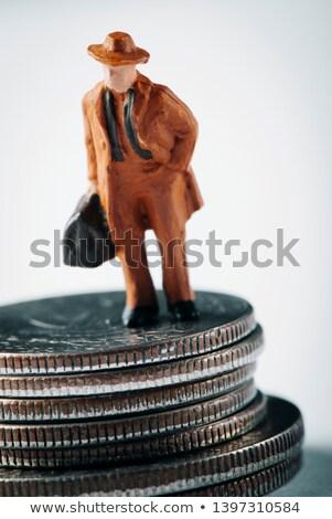 Miniatura homem mala dólar moedas Foto stock © nito