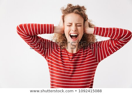 Angry blonde curly woman in casual clothes covering her ears Stock photo © deandrobot