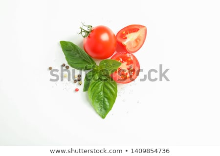 Organic Cherry Tomatoes with basil and pepper and rosemary in white wooden box on stone kitchen back Stock photo © DenisMArt