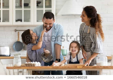 happy family cooking and having fun at kitchen Stock photo © dolgachov