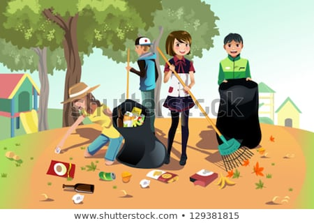 volunteers collecting garbage and sweeping in park stock photo © robuart