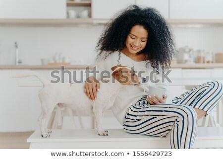 Shot aangenaam naar jonge vrouw gericht beneden Stockfoto © vkstudio