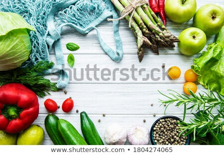 Tomatoes in a reusable bag on a wooden background. Zero waste concept Stock photo © galitskaya
