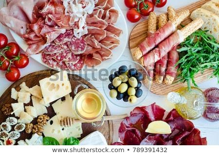 Antipasto plate. Appetizer board Stock photo © karandaev