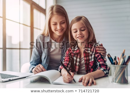little girl doing homework with her mom stock photo © photography33