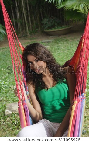 Young brown-haired woman laid in hammock Stock photo © photography33