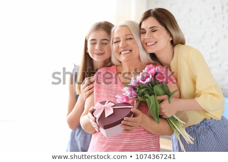 Granddaughter and grandmother with flowers Stock photo © photography33