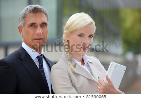Stock photo: Business duo outside with a laptop