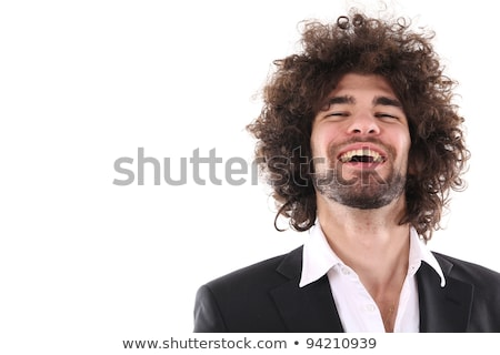 Cheerful dark-haired man posing in a studio Stock photo © wavebreak_media