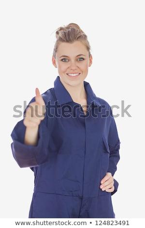 Female technician showing thumbs up sign stock photo © wavebreak_media