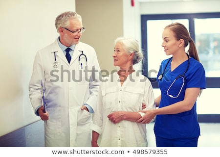 Doctor helping elderly patient in hall Stock photo © photography33