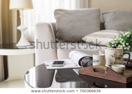 phone on wooden table in living room Stock photo © gewoldi