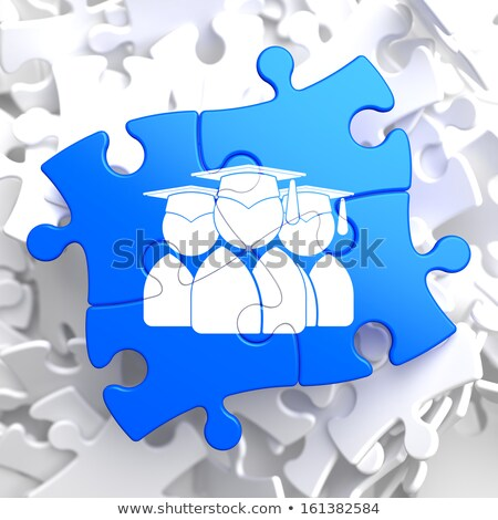 Group of Graduates Icon on Blue Puzzle. Stock photo © tashatuvango