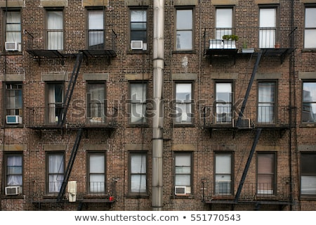 Stock Photo Fire Ladder At A Facade Of An Old Brick House In New York