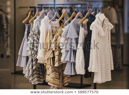 Toplama elbise asılı raf alışveriş siyah Stok fotoğraf © Virgin