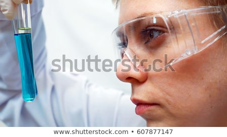 close up of scientist face in chemical lab Stock photo © dolgachov