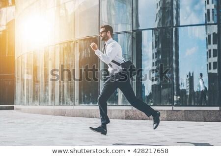 Business man running forward Stock photo © fuzzbones0
