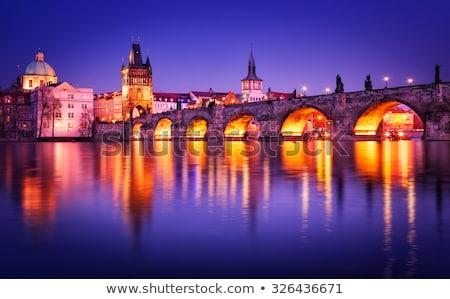 Charles Bridge is famous historic bridge that crosses Vltava river.  Stock photo © master1305