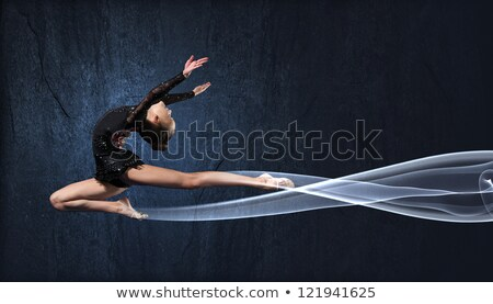 Girl in gymnast suit show athletic skill Stock photo © deandrobot
