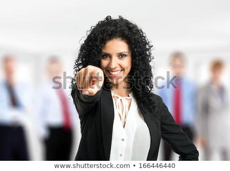 üzletasszony · mutat · ujj · kép · vonzó · fiatal - stock fotó © dolgachov