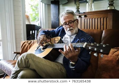 muzikant · ontspannen · home · viool · man - stockfoto © zurijeta