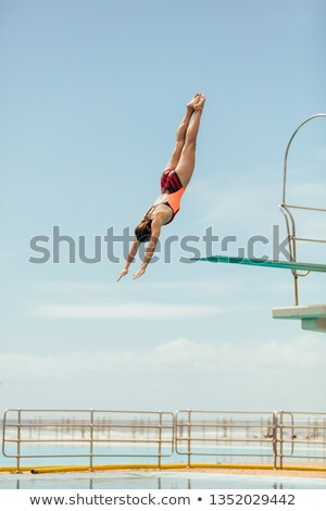 Woman athlete diving down Stock photo © bluering