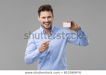 Man with blank card Stock photo © pressmaster