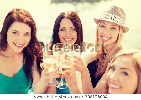 Group of friends celebrating womans birthday at outdoor restaurant Stock photo © wavebreak_media
