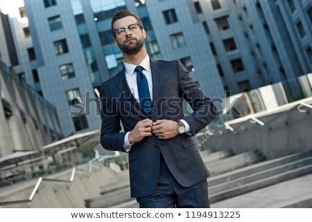 portré · fókuszált · koncentrált · férfi · öltöny · napszemüveg - stock fotó © filipw