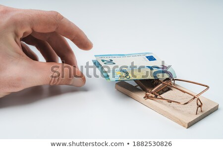 Hand Grabs $20 Dollar Bill in Mousetrap Isolated Stock photo © Qingwa