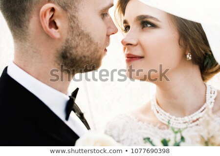 Bride and groom kissing in garden Stock photo © IS2