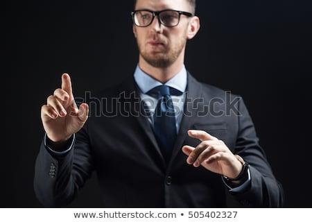Zakenman pak aanraken iets onzichtbaar zakenlieden Stockfoto © dolgachov
