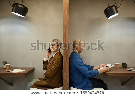 Senior man and woman working in cafe Stock photo © IS2