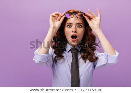 Woman taking off her sweater Stock photo © IS2