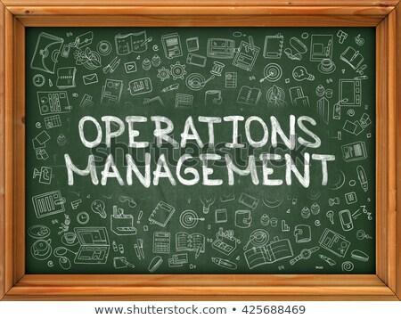 Green Chalkboard with Hand Drawn Operations Management. Stock photo © tashatuvango
