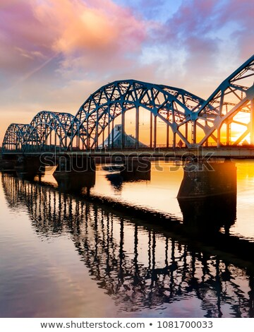 Panorama Riga ferrovia ponte Látvia pôr do sol Foto stock © benkrut