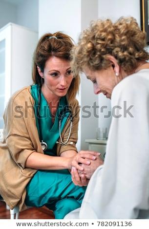 Senior woman with her home caregiver Stock photo © FreeProd