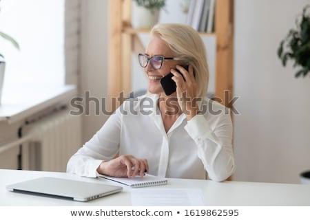 White businesswoman negotiating on smartphone Stock photo © RAStudio