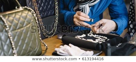 Jeweler Examining Diamond Through Loupe Stock photo © AndreyPopov