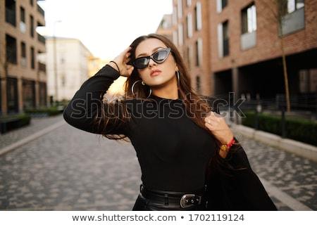 szexi · nő · sarkak · fekete · bőr · kanapé - stock fotó © acidgrey