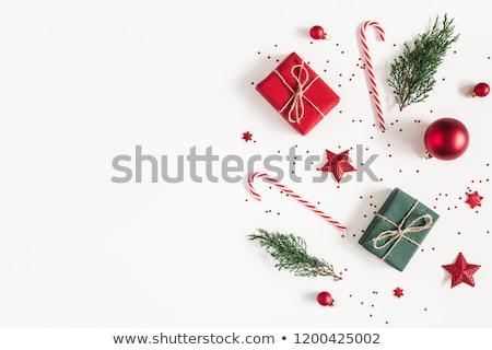 Karácsony ajándékdobozok fenyőfa ág fedett hó Stock fotó © karandaev