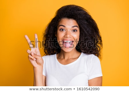 Emotional excited young pretty african woman isolated over violet background holding pineapple. Stock photo © deandrobot