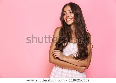 mosolygó · nő · haj · közvetlenül · kamera · piros · nő - stock fotó © deandrobot