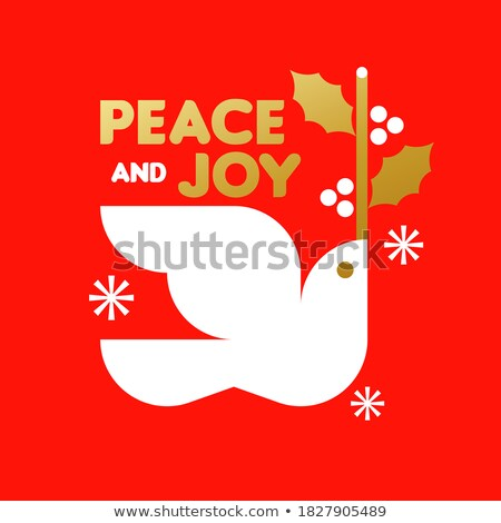 Christmas card with white dove holding holly branch and wishes Stock photo © ussr