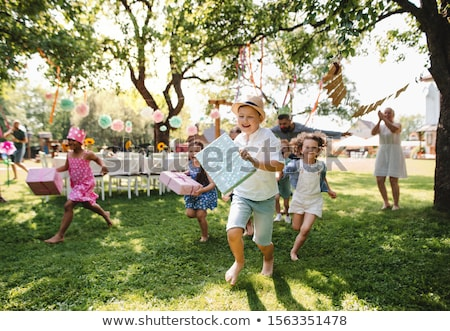 girls with gifts on birthday party at summer Stock photo © dolgachov
