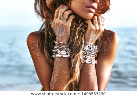 Happy slim tan women on the beach in sunset. Travel and happines Stock photo © dashapetrenko