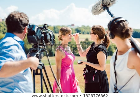 Model in the make-up during video shoot on production set Stock photo © Kzenon