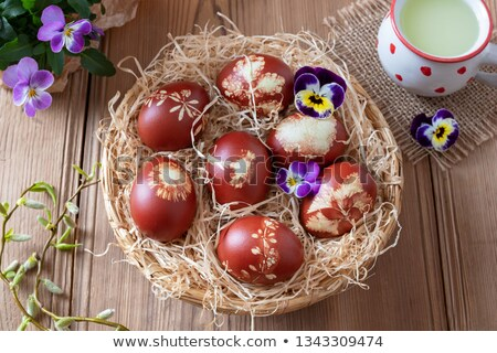 Easter eggs dyed with onion peels and a cup of whey Stock photo © madeleine_steinbach