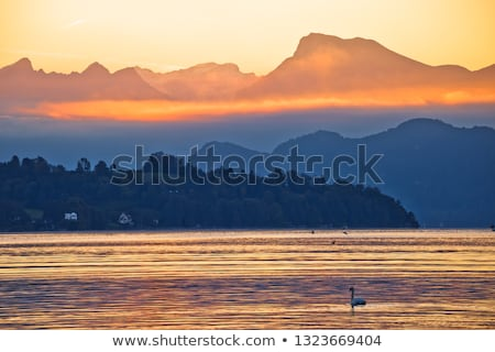 lake luzern and rigi mountain peak morning golden glow view stock photo © xbrchx