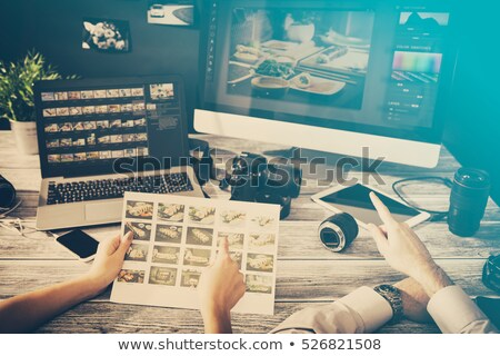 Editor Looking At Photograph In DSLR Camera Stock photo © AndreyPopov